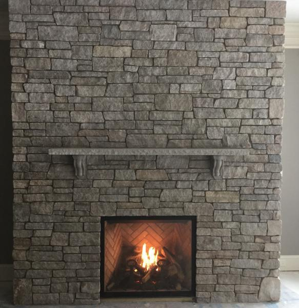 Colonial Tan Ledgestone thin veneer fireplace with a limestone mantel