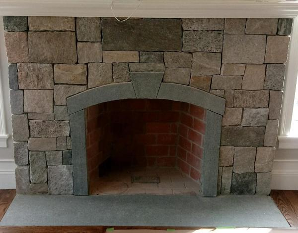 Fireplace with New England Blend square and rectangle veneer with Bluemist accents