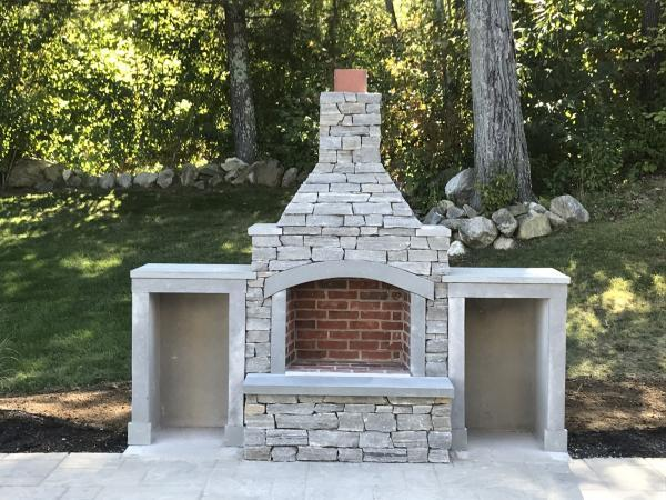 Fireplace with Berkshire ledge thin veneer and bluestone trim