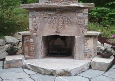 Sterling Tan outdoor fireplace with Idaho oversized flagging patio