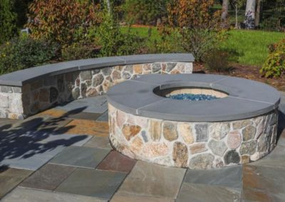 Full color natural cleft bluestone patio and thermal bluestone wall caps