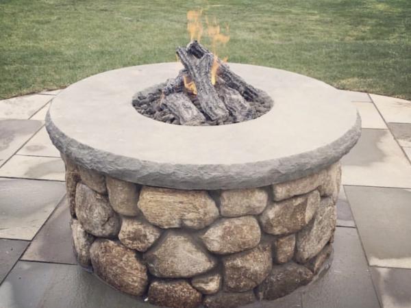 New England fieldstone fire pit with bluestone cap