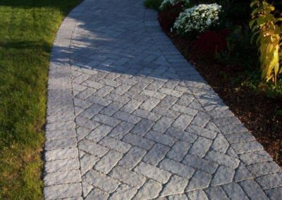 Cassova walkway laid in a herringbone pattern granite color
