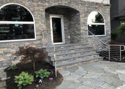 NE ledgestone thin veneer with bluemist treads and silver Idaho flagging walkway