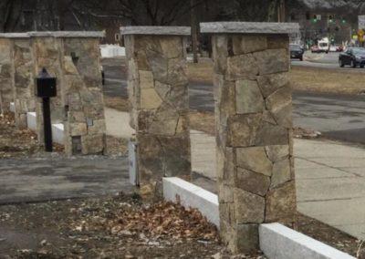 Autumn hill mosiac veneer pillars with grey granite caps and curbing
