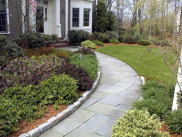 Cobblestones used for edging a Bluestone walkway