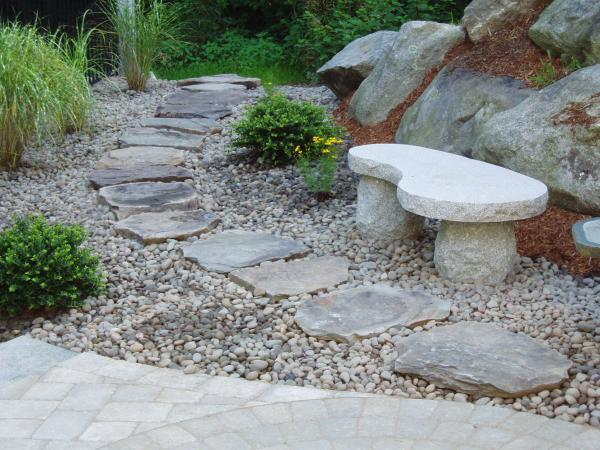 Granite bench set in Mexican Beach Pebbles