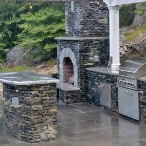 Stanstead Granite outdoor kitchen countertop with CT Whitestone veneer