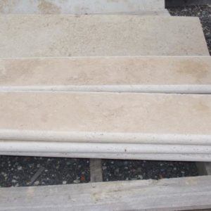 Travertine treads with bull nose edge