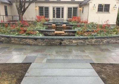 "PA Ashlar wallstone with 3"" bluestone cap and natural cleft bluestone paving"