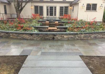 "PA Ashlar wallstone with 3"" bluestone cap and natural cleft bluestone paving"
