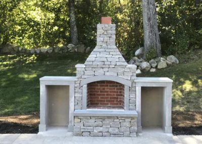 Fireplace with Berkshire ledge thin veneer and bluestone trim