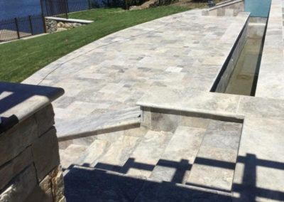 Silver travertine patio, wall coping and stair treads