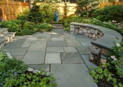 Natural cleft bluestone patio with fieldstone sitting walls