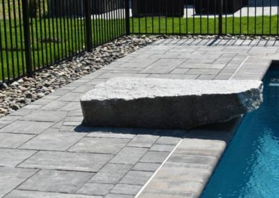Beacon Hill Flagging steel mountain pool deck with diving rock