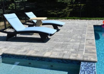 Beacon Hill Flagging steel mountain pool deck with bull nose coping